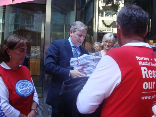 ANF (Vic. branch) Secretary Lisa Fitzpatrick, Assistant Secretary Paul Gilbert and Assistant Secreatry Pip Carew (not pictured) delivering thousands of petitions to Health Minister David Davis (centre) - December 16 2011